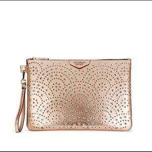 Victoria's Secret Bags - NWT ROSE GOLD VICTORIAS SECRET LARGE WRISTLET